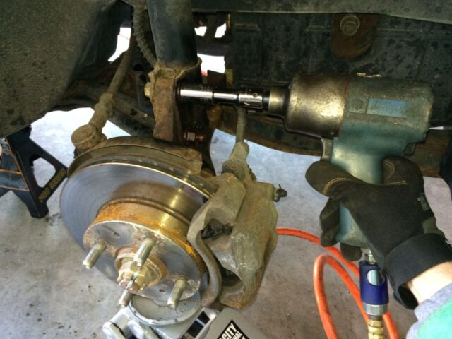 Removing nuts from lower strut bolts