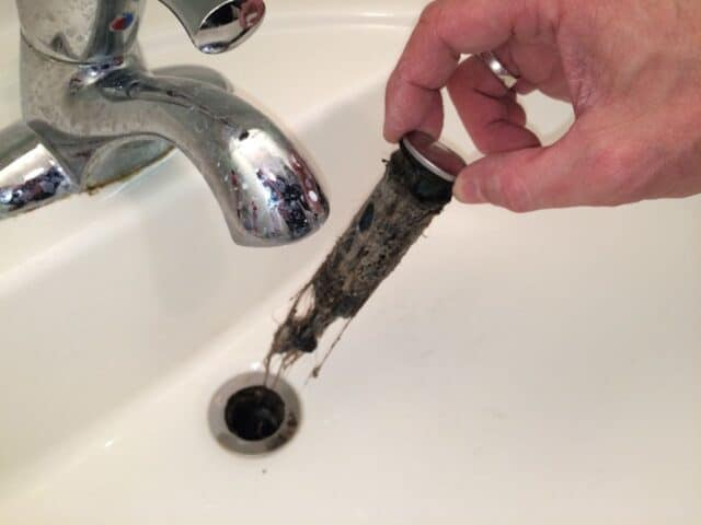 see why the drain was not draining sick step 4 clean the drain plug