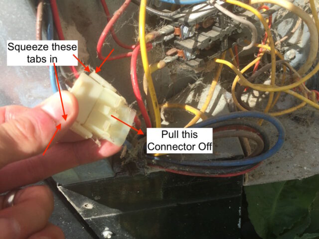 Disconnecting AC Condenser Motor Electrical Connector
