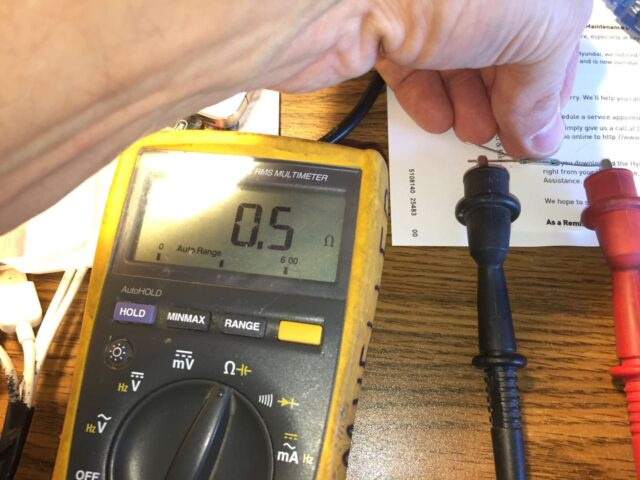 Using a multimeter to determine the normally open leg of the reed switch