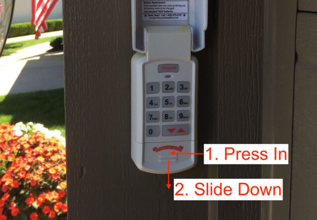 Instructions for opening the battery door of the garage remote keypad