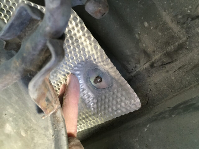 """Put the heat shield on next, on top of the 2"""" washer"""