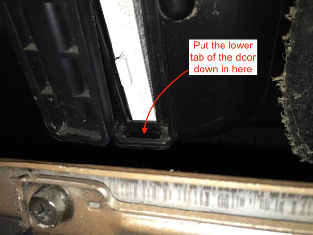Directions for reinserting the bottom of the filter door