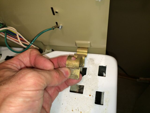 Kenmore 90 Series Washer Fills Slowly-Spring Clip Hooked into Back