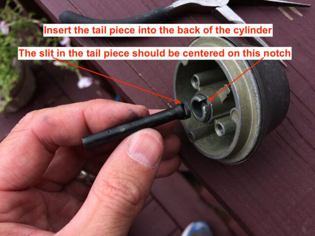 Center the tail piece slit with the cylinder's notch