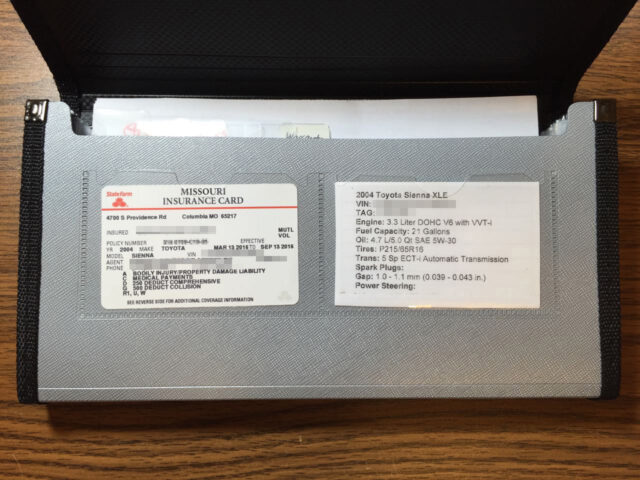Picture of insurance card and custom vehicle info card in two clear pockets on front of organizer