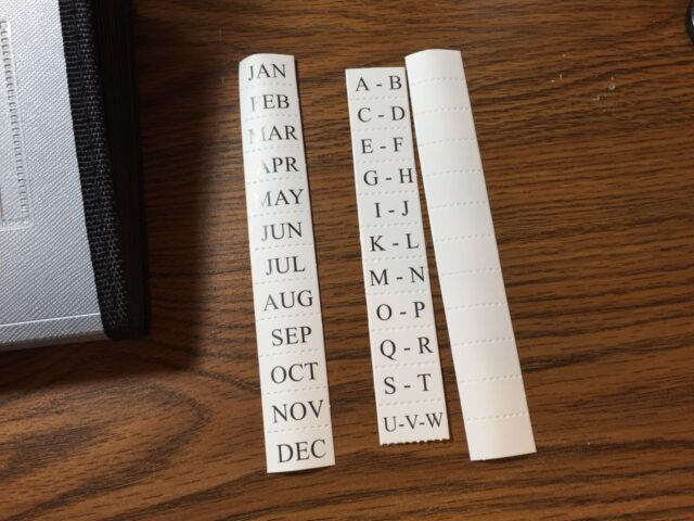 tear apart organizer insert tabs, some with months, some alphabetical, and some blank