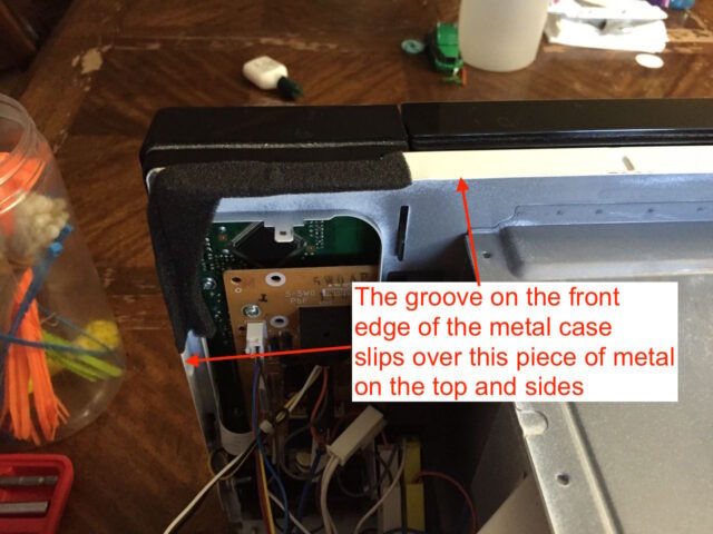 The case groove will slip over these metal tabs