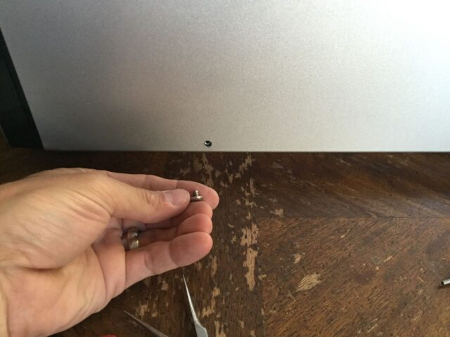 Reinstall the single phillips-head screw on the right side