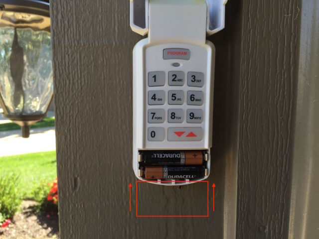 Diagram of how to reinstall the garage door keypad battery door