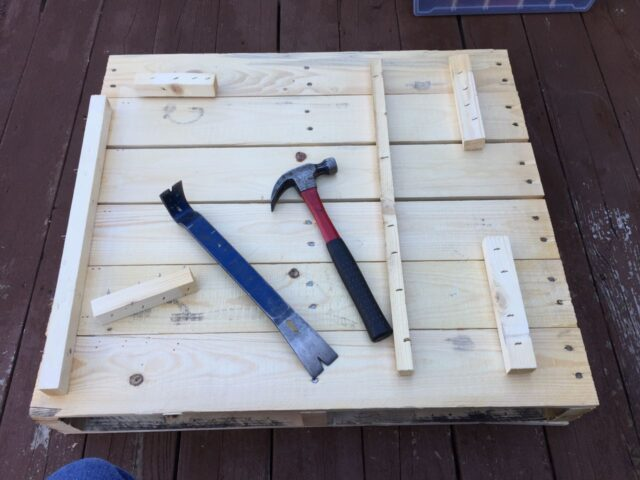 Nail Bar and Hammer on Pallet