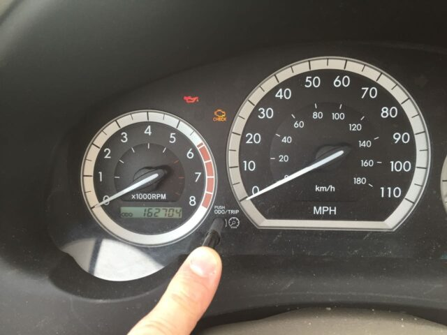 Press and hold and keep holding down the ODO/Trip Button