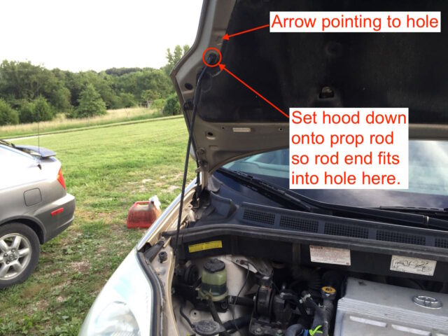 Instructions for inserting the hood prop rod into the hood