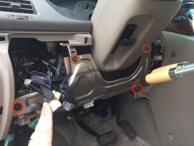 Lower driver's dash metal panel bolt locations