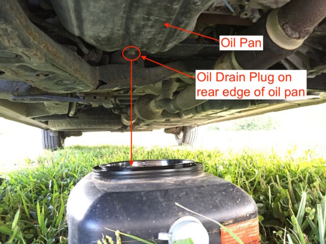 Oil pan below oil drain plug