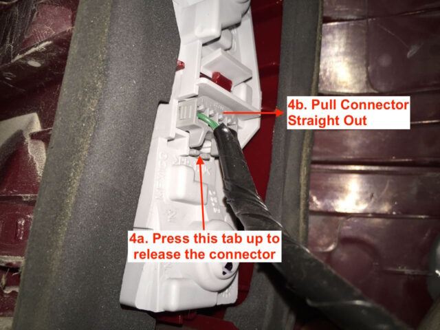 Press the tab and pull out the electrical connector